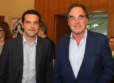 Director Oliver Stone wishes SYRIZA's Tsipras 'good luck' in leading Greece as pair meet