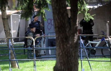Special units disperse opposition protestors in a park in Skopje