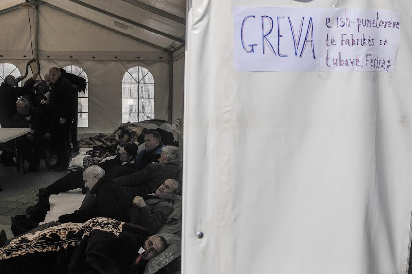 Former workers of a plant start a hunger strike in front of the government of Kosovo's building