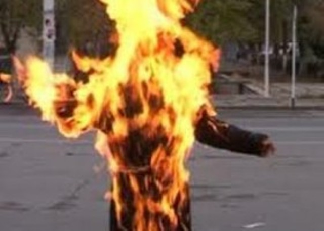 A teacher terrorizes his students by setting himself on fire