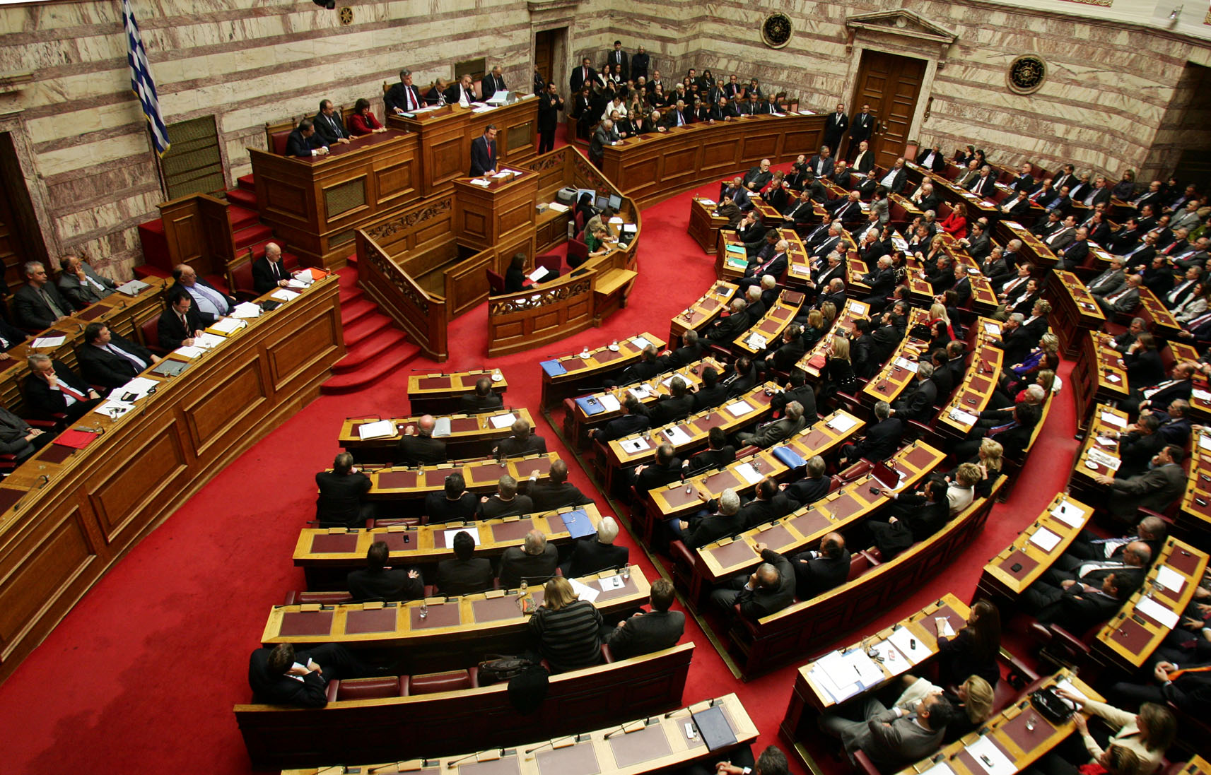 Greek government brings draft budget to Parliament