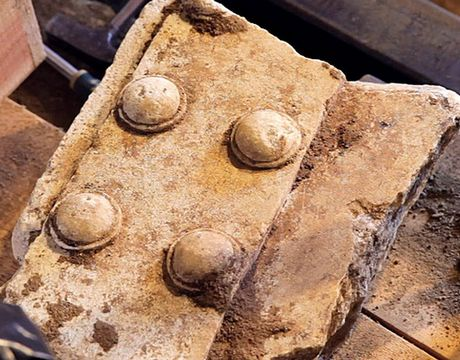 Fragments of a marble door found in the third chamber of the tomb of Amphipolis