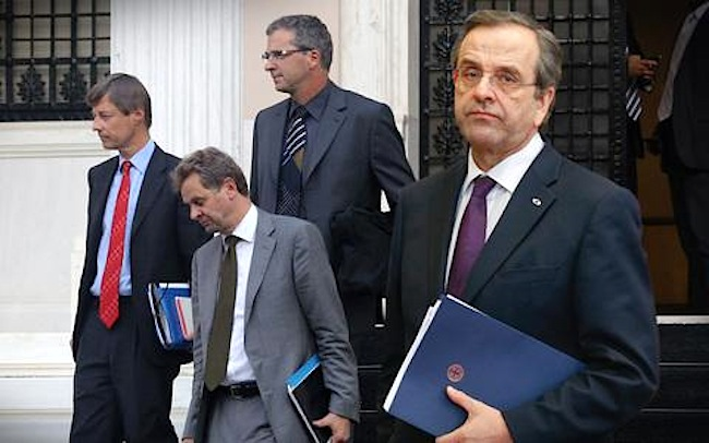 Government sets up talks with troika in Paris in bid to break deadlock