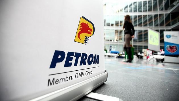 Romania's top oil company logs halved profit in 2014