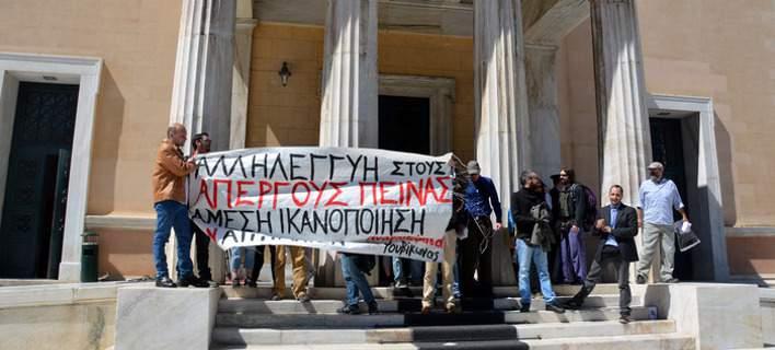 Waves of public building captures across Greece