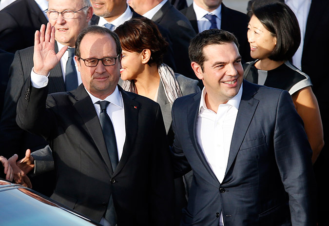 Hollande shows support to Tsipras administration in official visit to Athens