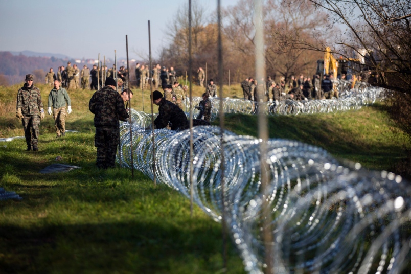 Slovenia is building wired fence on sections of its border with Croatia
