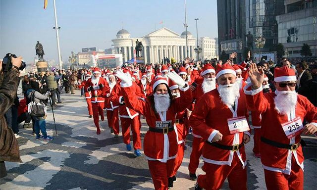 Santa Clauses run in Skopje for the end of the year holidays