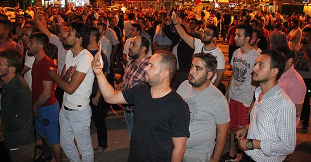 Crowd marches in central Turkey after claiming power blackout was coup attempt