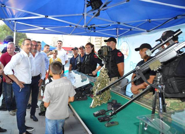 Police fair in the south of Albania, tourists check out the weapons