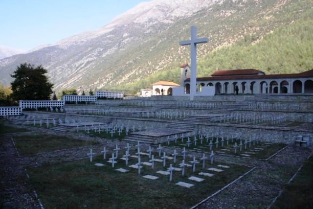 Why has the issue of Greek cemeteries in Albania come to a gridlock?