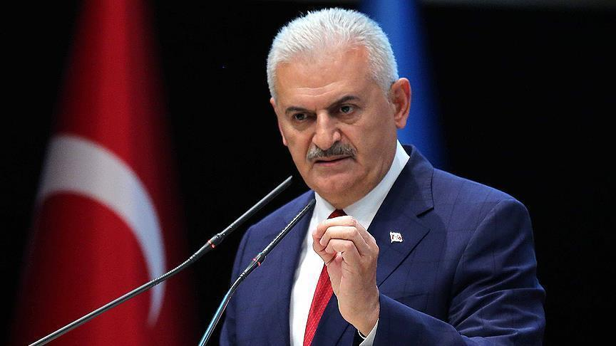 Turkish PM criticizes Clinton over promise to arm Syrian Kurds