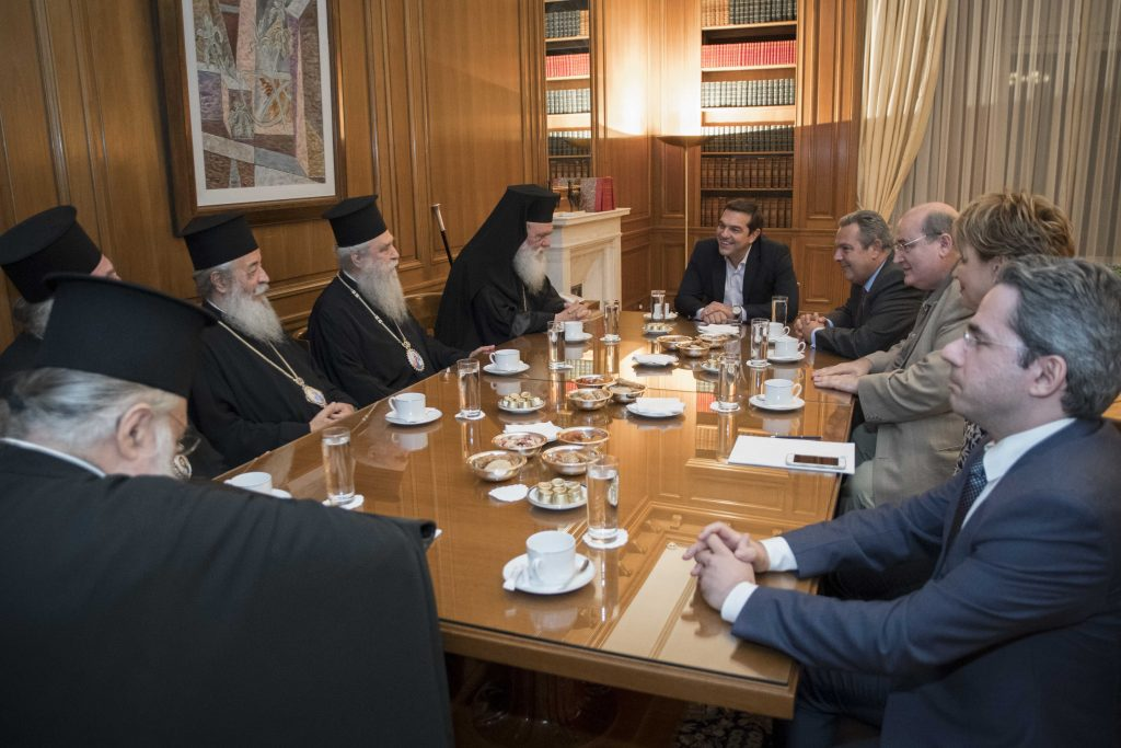 Tsipras intervenes to avert crisis in government – church relations