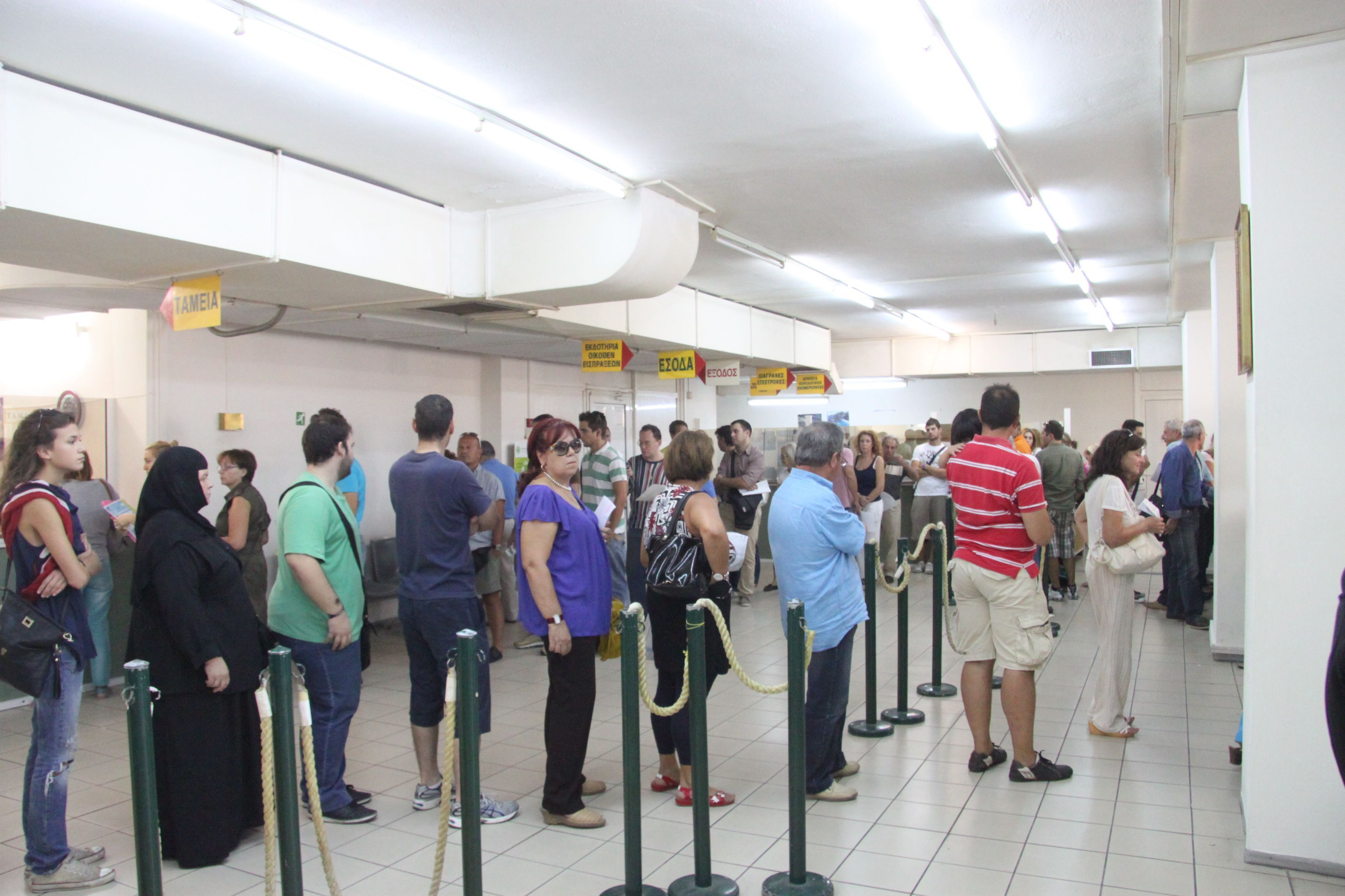 Greek taxpayers, pensioners brace for more austerity