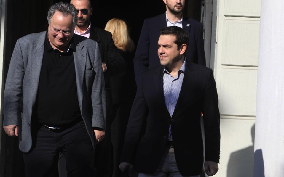 Nikos Kotzias rushes to Maximos Mansion