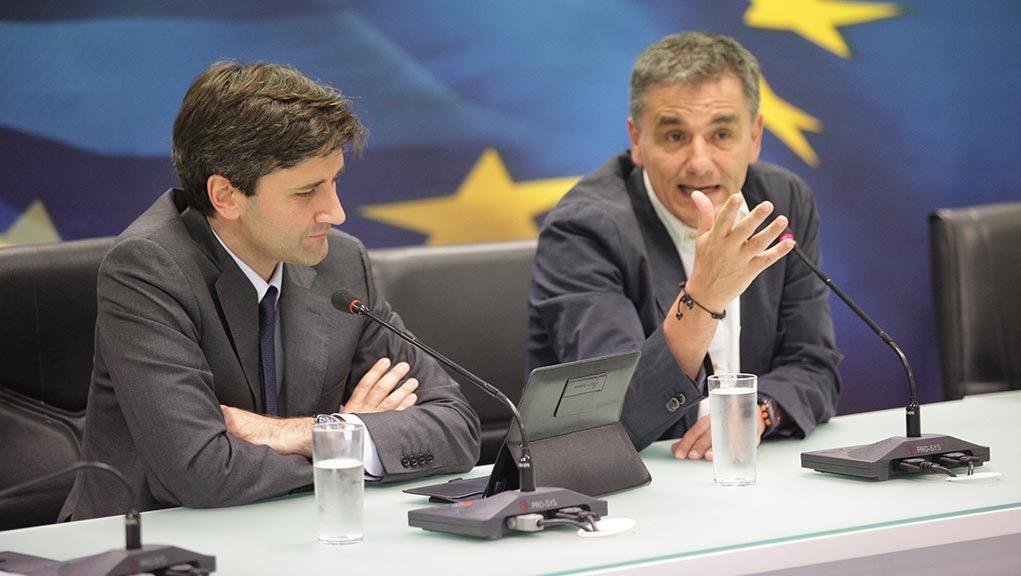 Greece, creditors discuss putting off legislated pension cuts