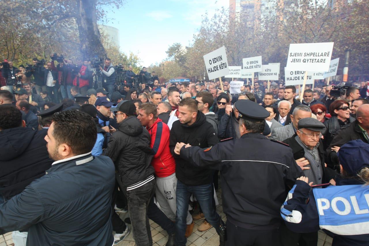 Riot police and protesters clash in Tirana