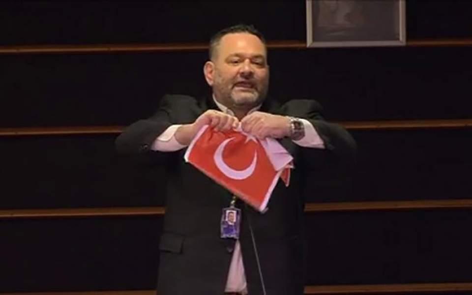 Greek far-right MEP tears up photocopy of the Turkish flag
