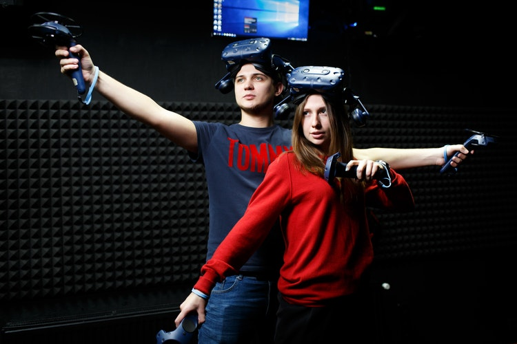 man and woman wearing black VR headsets byVladislav Skripchenko
